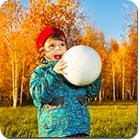 boy with ball in the autumn