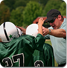 Coach encouraging players