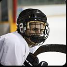Hockey player sitting on sidelines